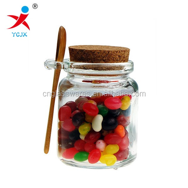 clear glass candy jars with top cork lid and wood spoon /glass jar for food storage