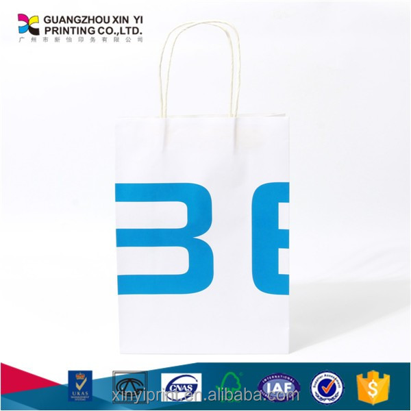 white fancy paper gift bag with logo