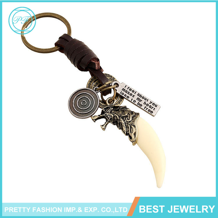 Hot sale Vintage men's braided leather key chain animal charm wolf tooth key chain