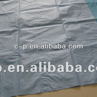 Surgical table cover with SMS