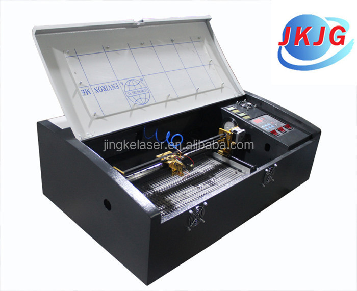 Cheap desktop jk-3020 40w co2 small laser wood acrylic leather engraving cutting machine