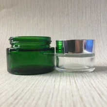 green 1 oz glass jars with metal lids for face cream