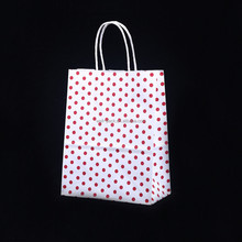 High quality wholesales custom printed brand name paper shopping bag