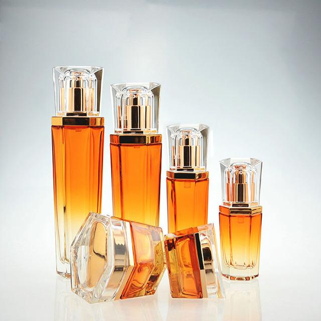 2018 New Design Charming Cosmetic Glass Bottle Set for Cream Lotion Toner Gradient Orange