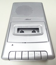 Classic audio cassette player in shoe box size with handheld