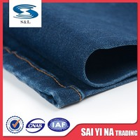 Stock spandex polyester twill fire resistant jeans cotton denim fabric factory