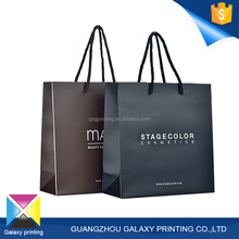 Fashion cheap custom printing design branded slogan blown and black paper shopping bag with cotton handle for clothing company