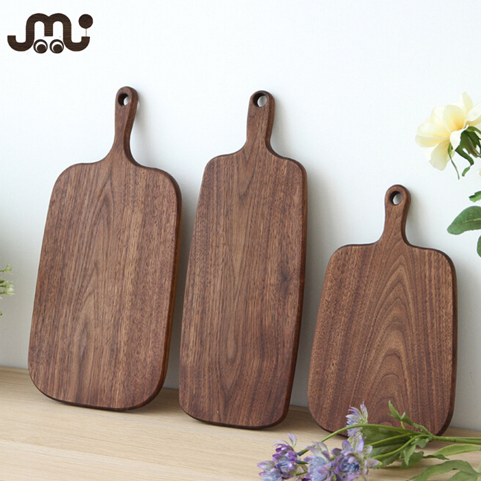 Carved one piece walnut wooden food serving board