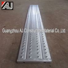 Aggressive non-slip surface perforated steel scaffolding planks used for construction