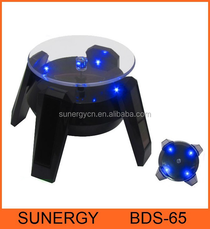 Solar energy and AA battery powered rotating solar display stands for tiles