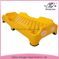 Professional manufacture colorful stackable sleeping plastic child cot bed