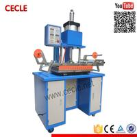 Portable hard cover embossing machine