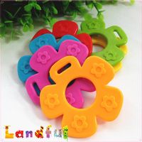 New Wholesale Colourful Flower Shape Bpa Free Baby Adapter Silicone Sew In Teether Toy For Baby Gift