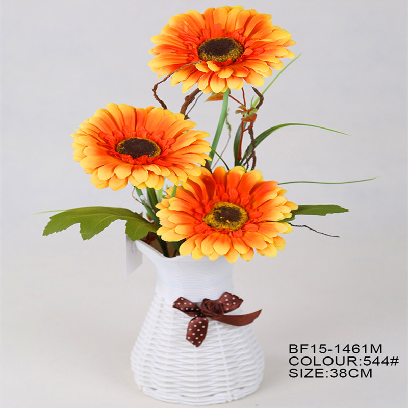 Artificial orange colour gerbera flower with white plastic basket