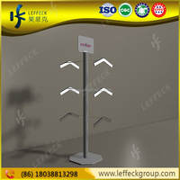 Shopping mall widely used creative metal floor standing t-shirt display stands