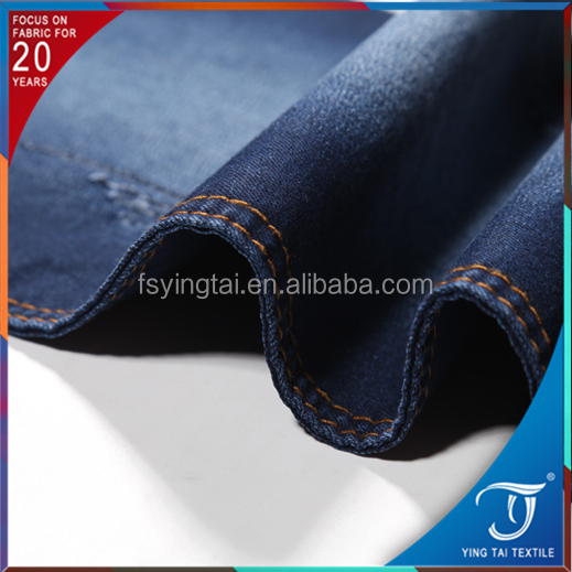 Stock lot spandex cotton polyester rayon stretch denim fabric for man jean pant