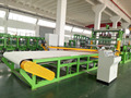 Tire horizontal cord fabric bias cutting machine