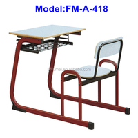 wooden student school desk and chair