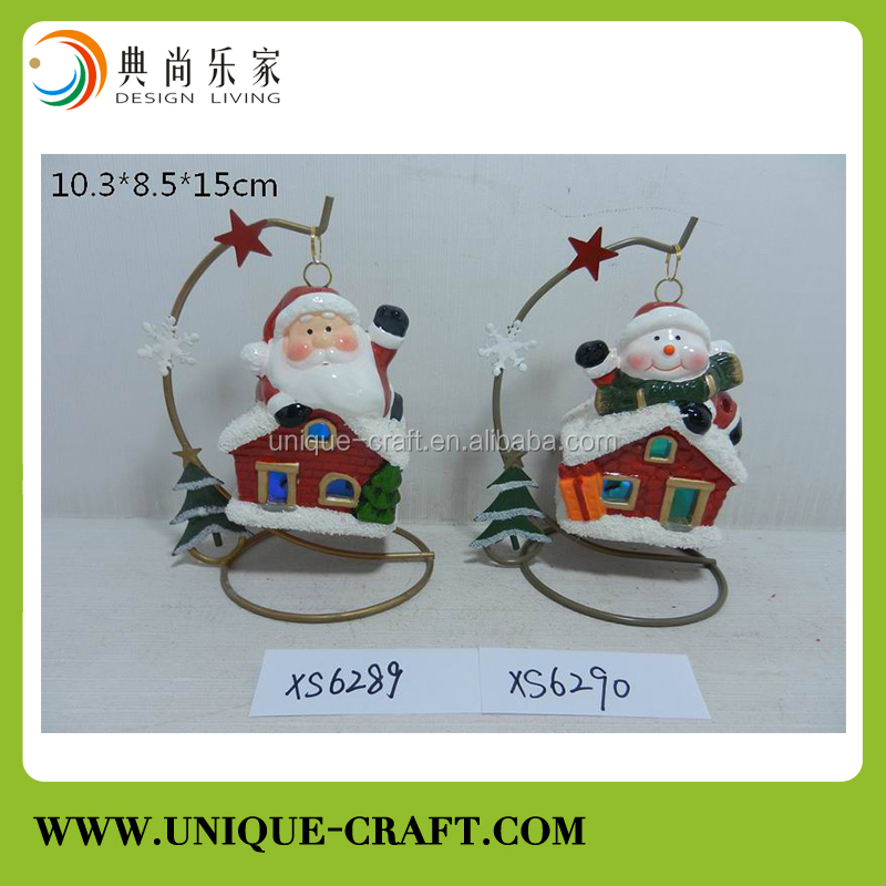 christmas lighted ceramic village houses with santa claus