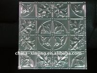Decorative suspended metal ceiling tile
