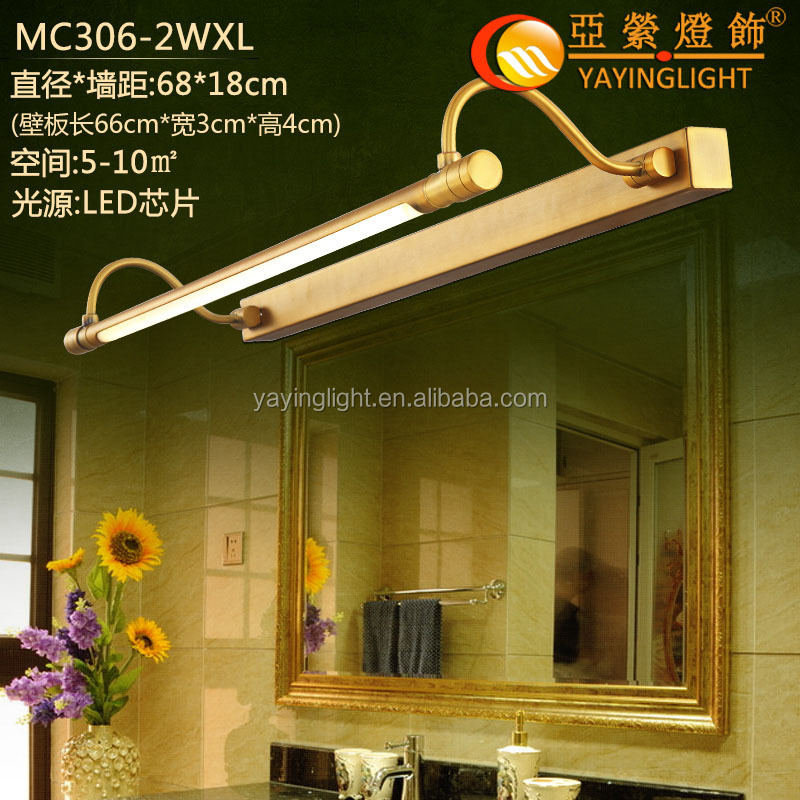 LED brass wall sconce in front of mirror, LED track wall sconce for bath room