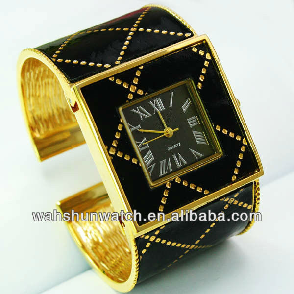 2013 trend design gold color vogue lady's large wristband bangle watch