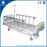 China BT-AM213 hospital cheap manual 2 crank patient clinic bed and mattress with IV pole/side rails/central wheels