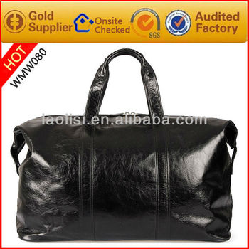 Guangzhou factory direct sell real leather travelling bag leather duffel bags wholesale