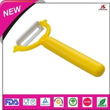 colorful fruit peeler with plastic handle