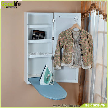 Household wooden ironing board in cabinet for space saving rooms
