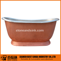 Luxury cast iron spa tub with copper skirt