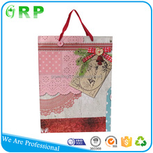 Luxury design custom printing daily paper gift bag with ribbon handle