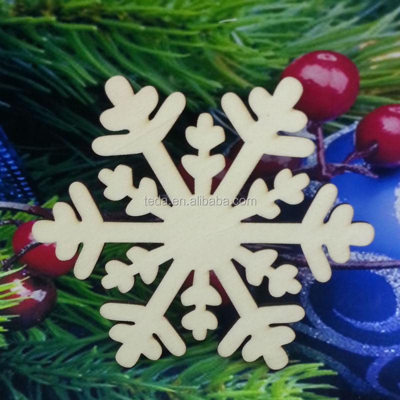 Make these cute Christmas snowflake wood ornaments with laser cut designs