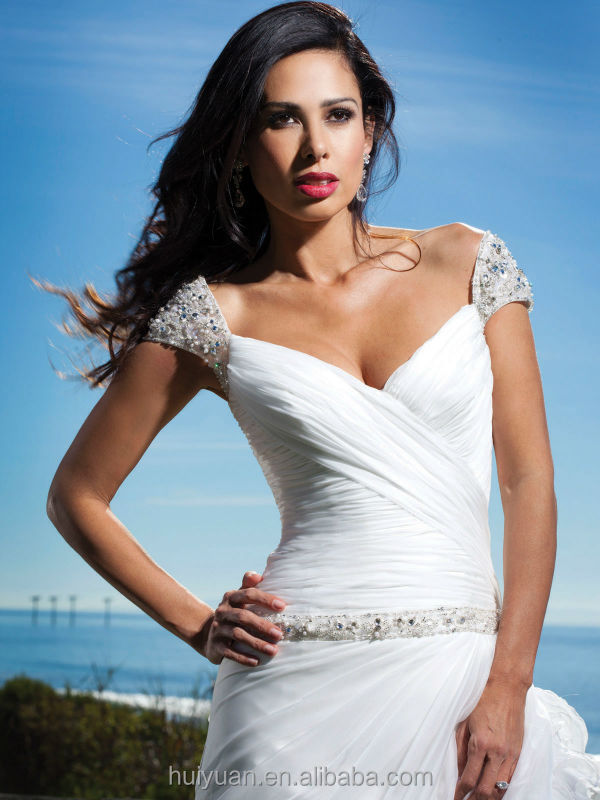 sweetheart neck low cut white beaded bell sleeve wedding dresses