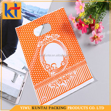 Yiwu factory OEM/ODM orange beautiful pattern eco-friendly die cut pe plastic bag.pe bag