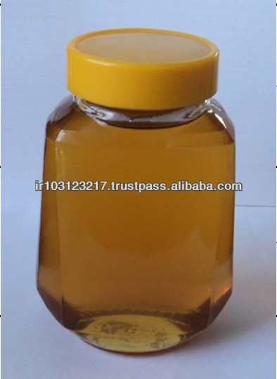 Yellow Liquid Glass Jar Packed Pure Natural Bee Thyme Honey
