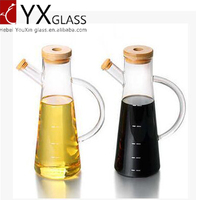 colored 580ml cooking oil glass bottles with handle ,glass oiler