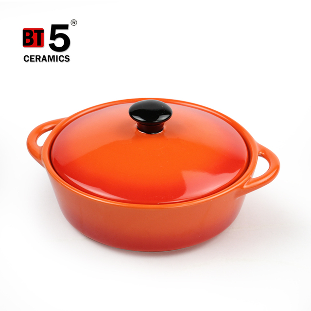Gradually changing color round ceramic cocotte casserole with handles