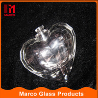 Best selling custom made heart shaped 50ml crystal crimp cap glass perfume bottle