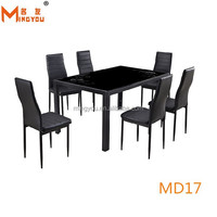black glass top metal dining table with 4 chairs