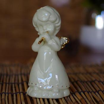 Indoor white ceramic statue with heart porcelain angel