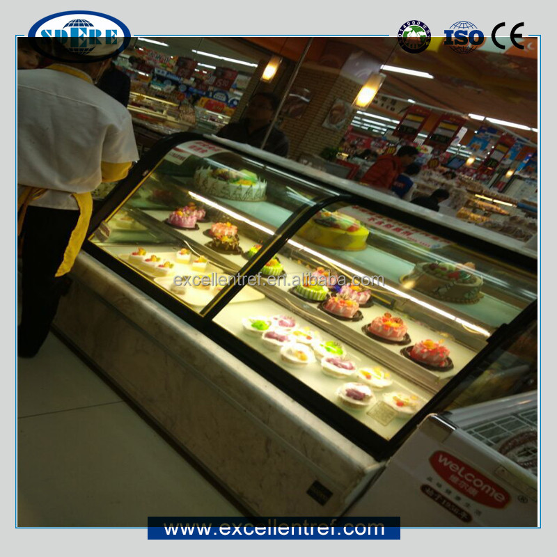 flat glass counter top cabinet used as refrigerated showcase for cakes