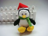 Christmas penguins plush toy with a red cap