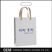 Wholesale newest OEM production recyclable shopping luxury paper bag