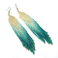 Feather look green with golden color bead new look earrings