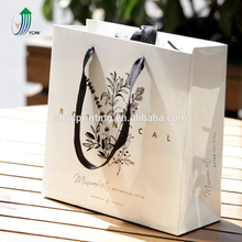 Fashion gross paper shopping bags with cut die handle