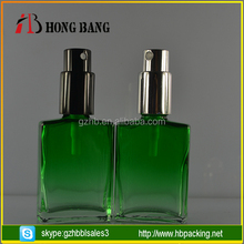 Custom logo 30ml green empty perfume glass bottle with spayer cap for sale