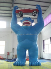 High quality giant advertising inflatable blue gorilla with a car for sale