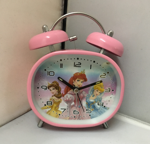 alarm clocks at target ,oval shape with twin bell alarm clock in pink color