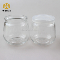 Factory stocked 180ml glass pudding bottle/jars , high quality glass canning jars with plastic lids